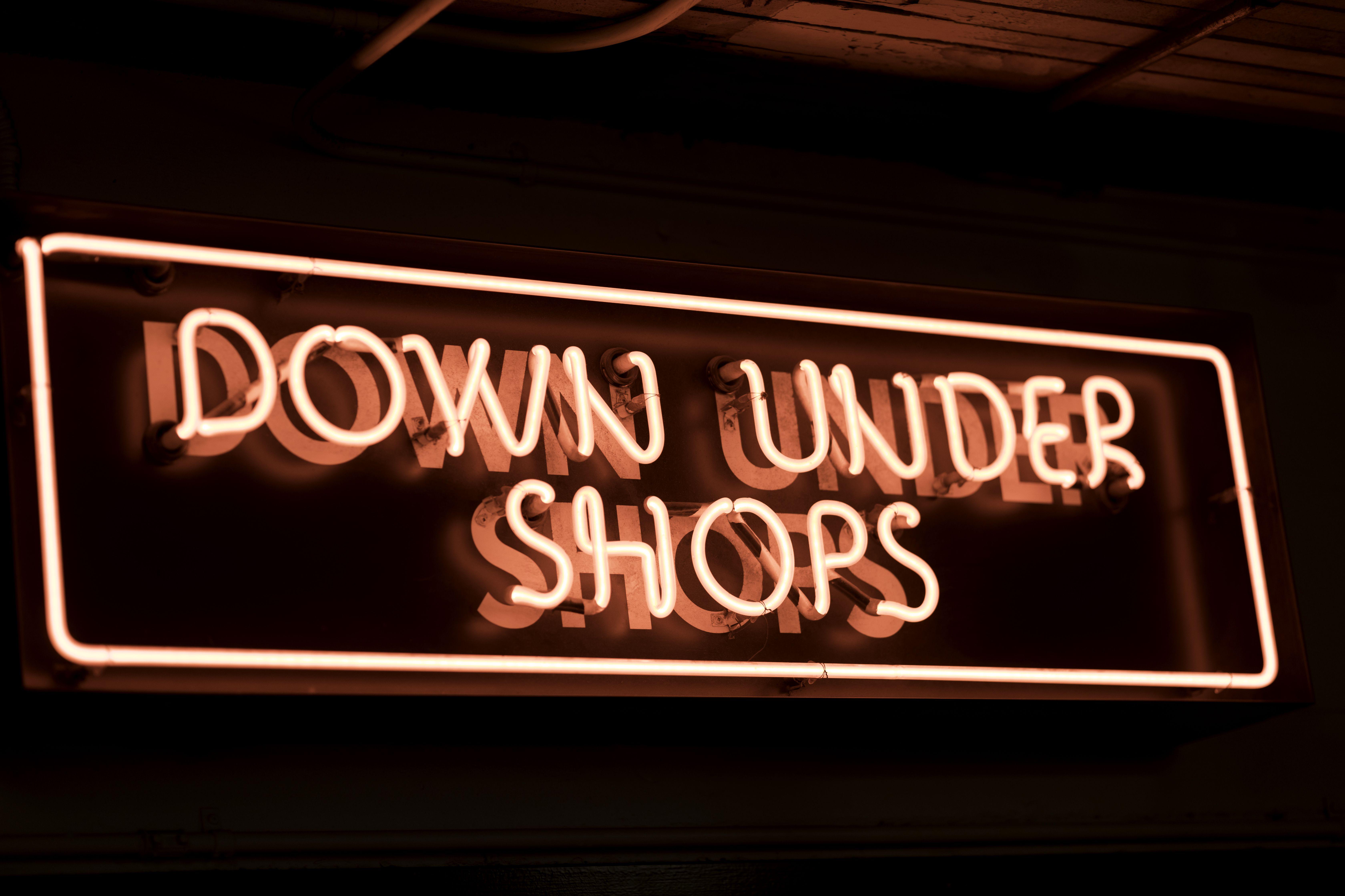 Red, glowing neon shop sign. Seattle, Washington, USA.