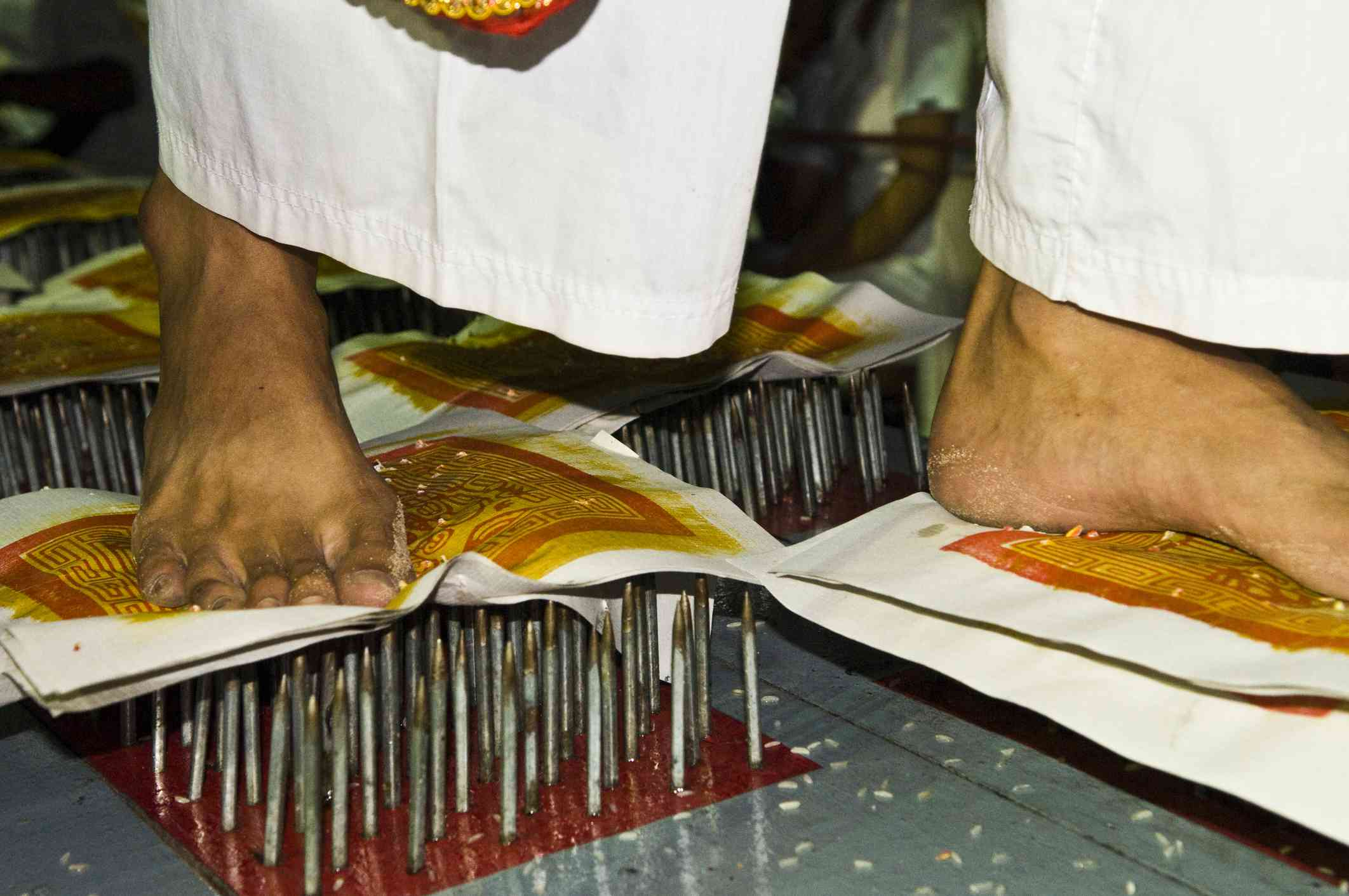Walking on nails during the vegetarian festival in Thailand