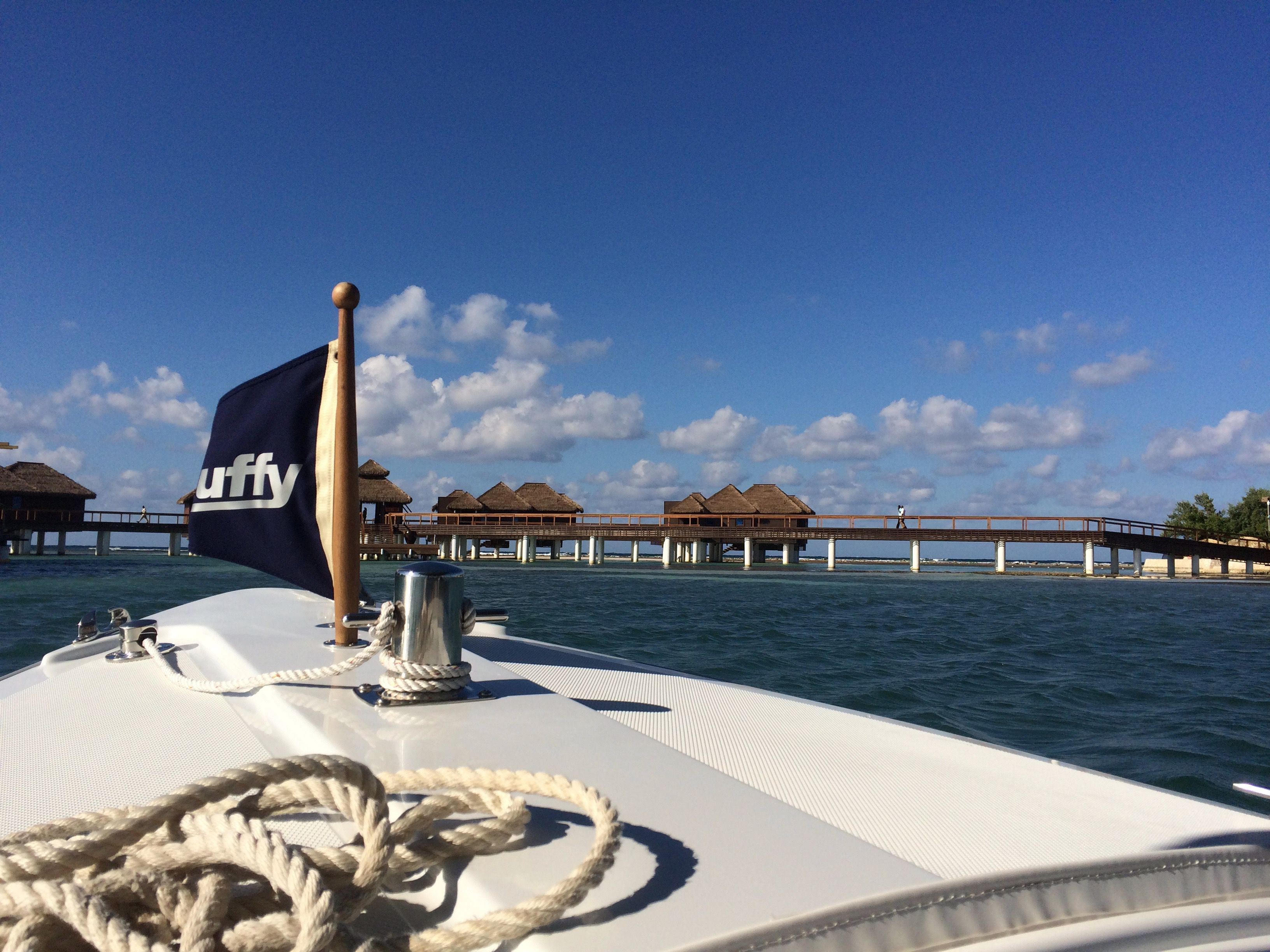 Boat to overwater villas