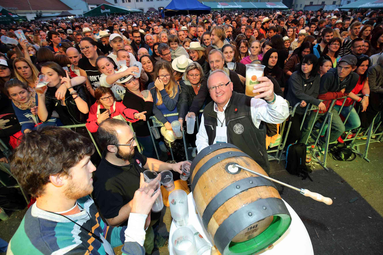 A large crowd drinking beer at Pilsner Fest