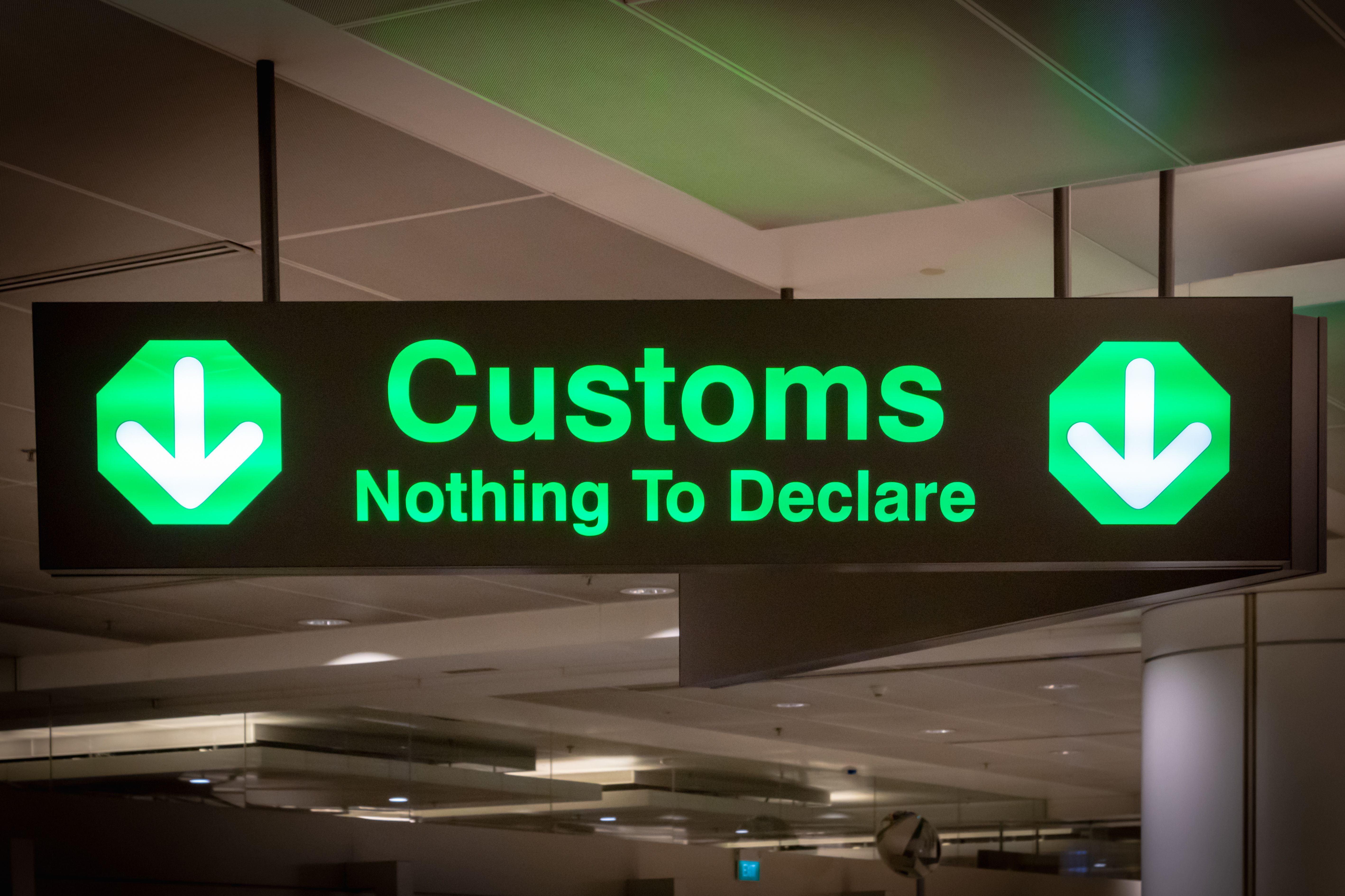 A green chanel customs sign for nothing to declare