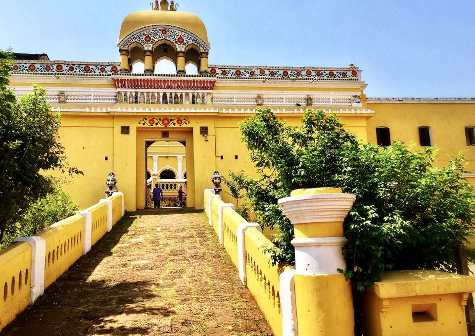 walkway into a yellow palace in Odisha.