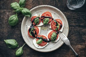 Caprese salad with San Marzano tomato and Buffalo Mozzarella and basil leaves