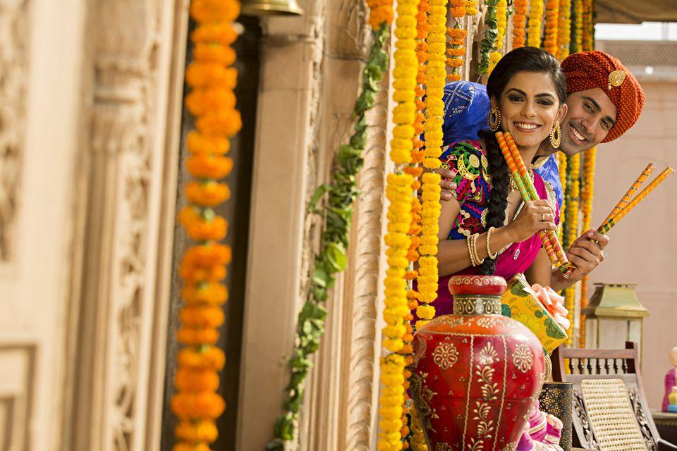 Navaratri festival in India. Couple holding dandiya sticks.