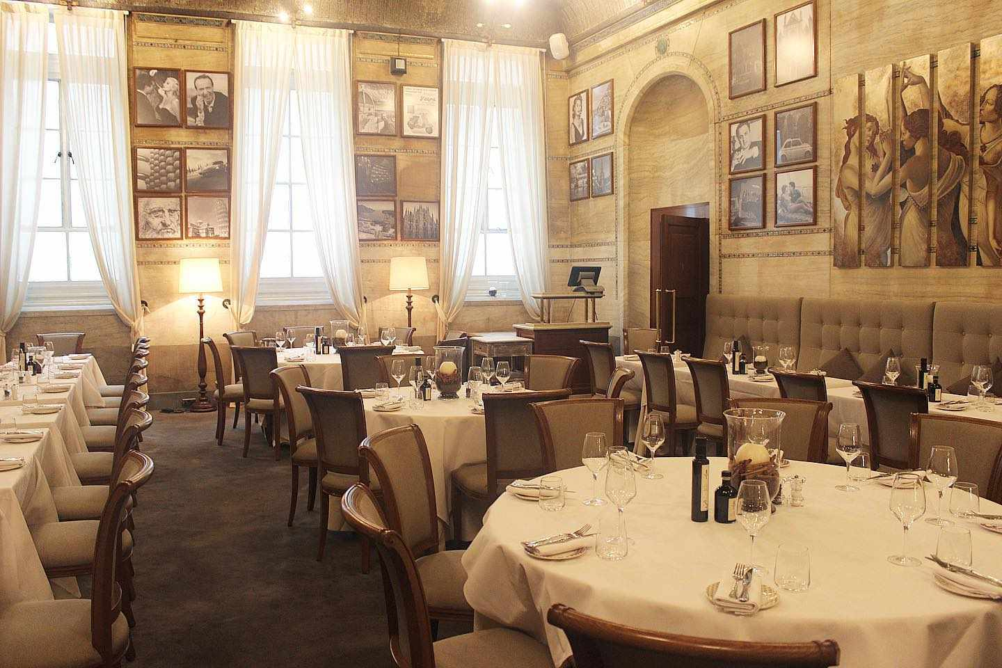 Historic Cream and white private dining room at Ristorante Granaio with old photos on the wall