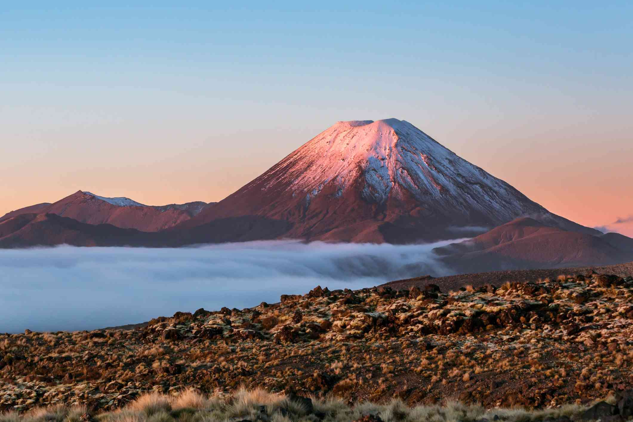volcanic mountain rising out of rocky landscape