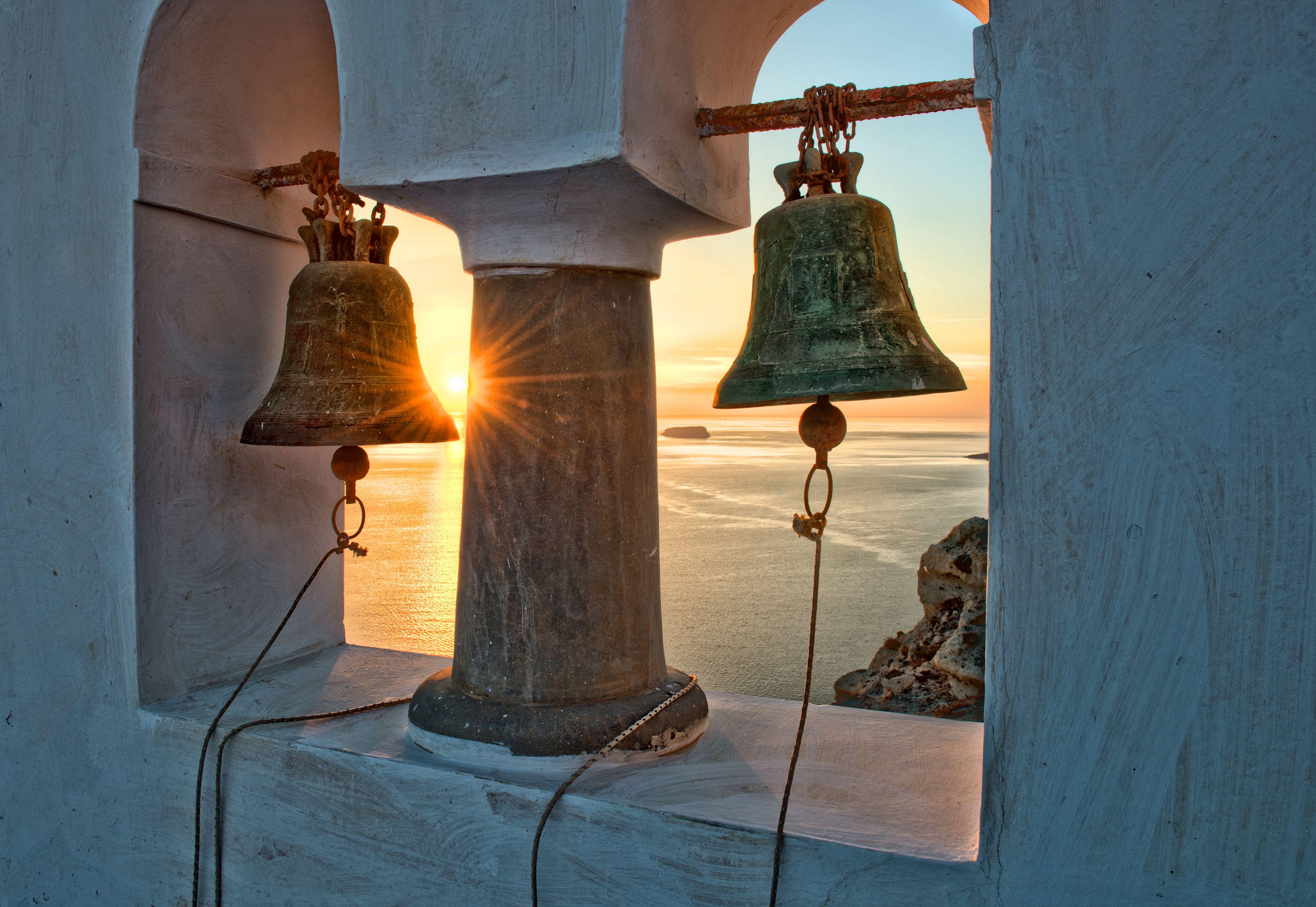 Santorini chapel bells at sunset