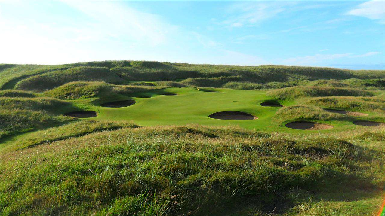 Golf course with long roughs and several sand traps