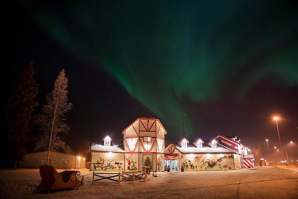 Santa's House in the North Pole with the Northern Lights in the sky