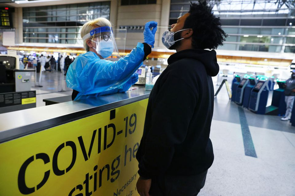 Man receiving COVID 19 test in the airport