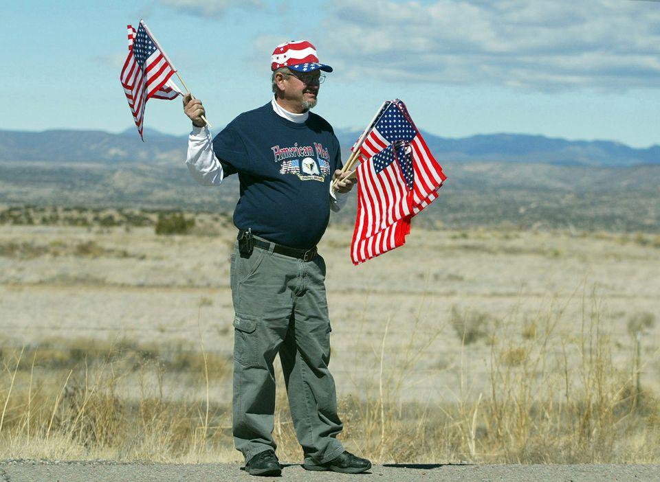 Military supporter waits for returning veterans