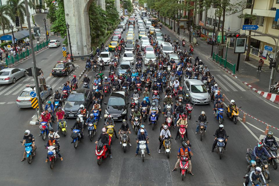 Motorbikes and cars on a road in Bangkok