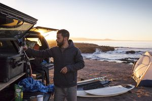 Surfer Prepares for Day of Adventure