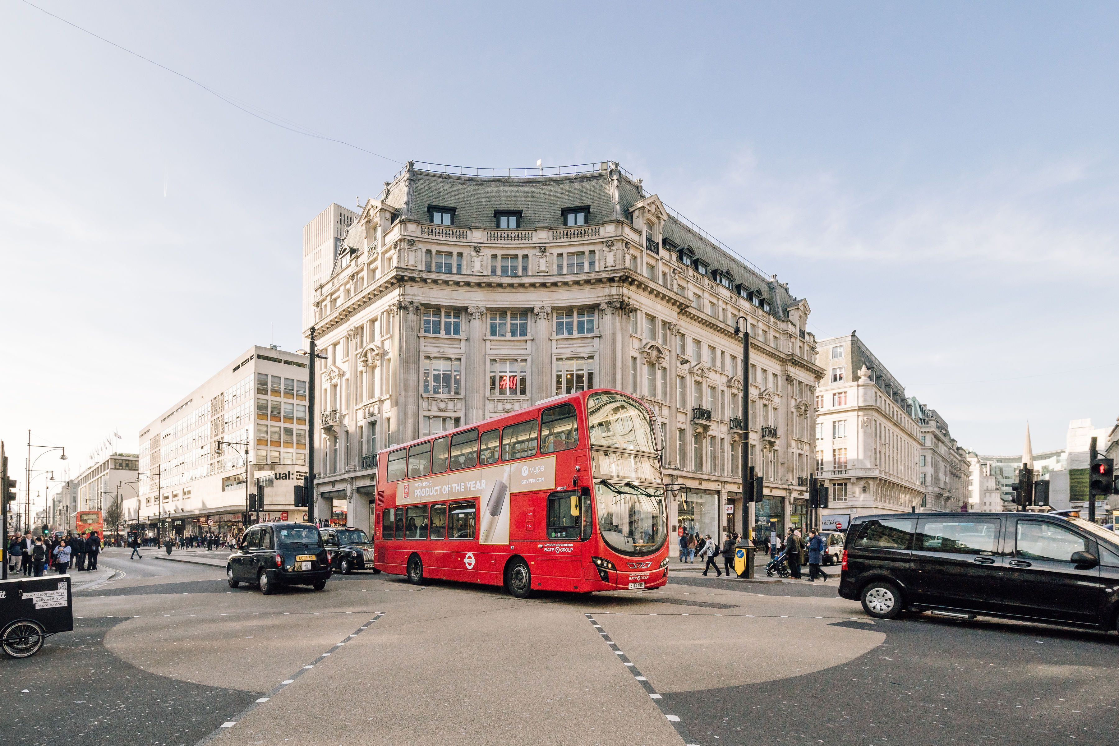 marble arch with a double decker bus outside