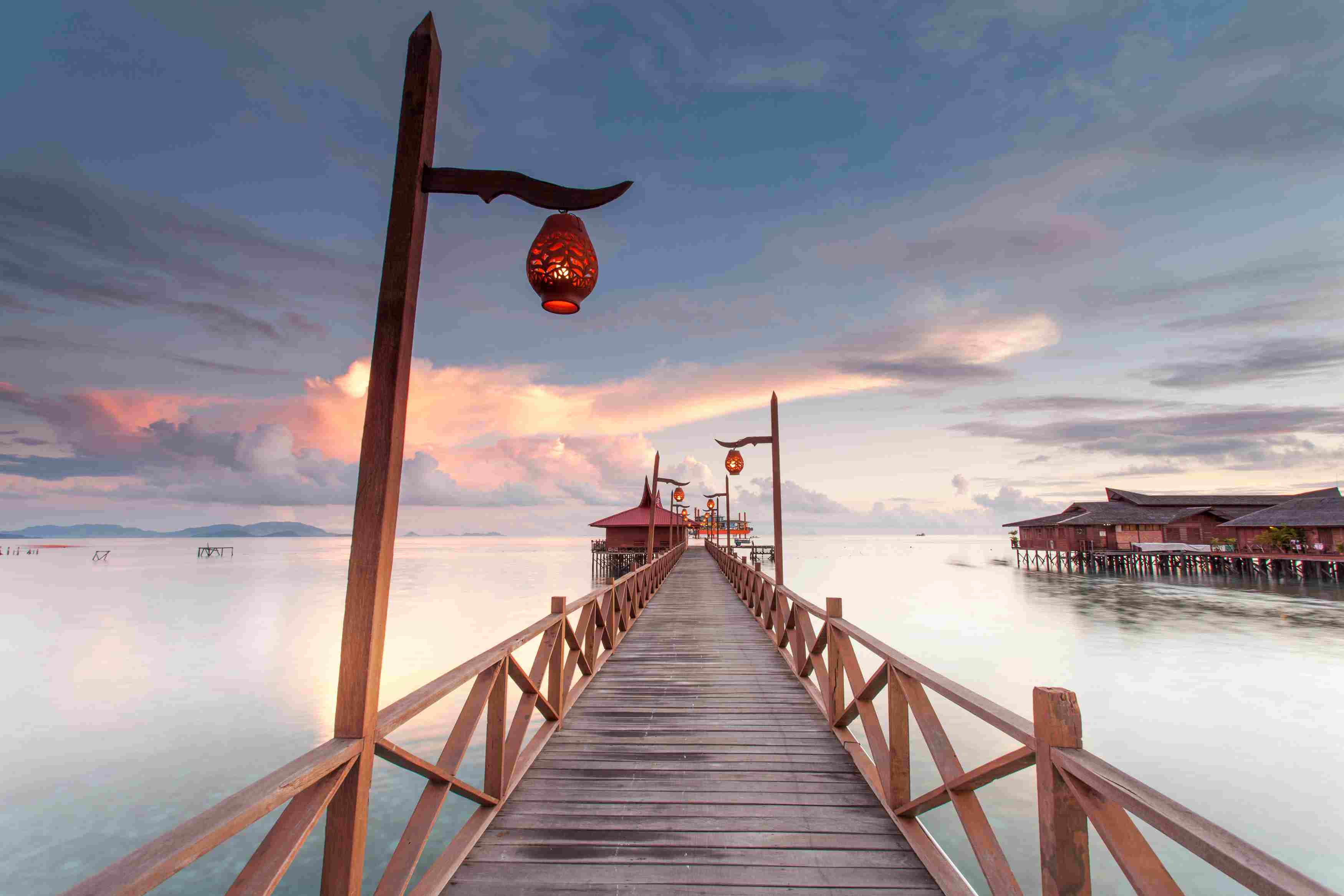 View Of Pier On Mabul Island In Malaysia During Sunrise