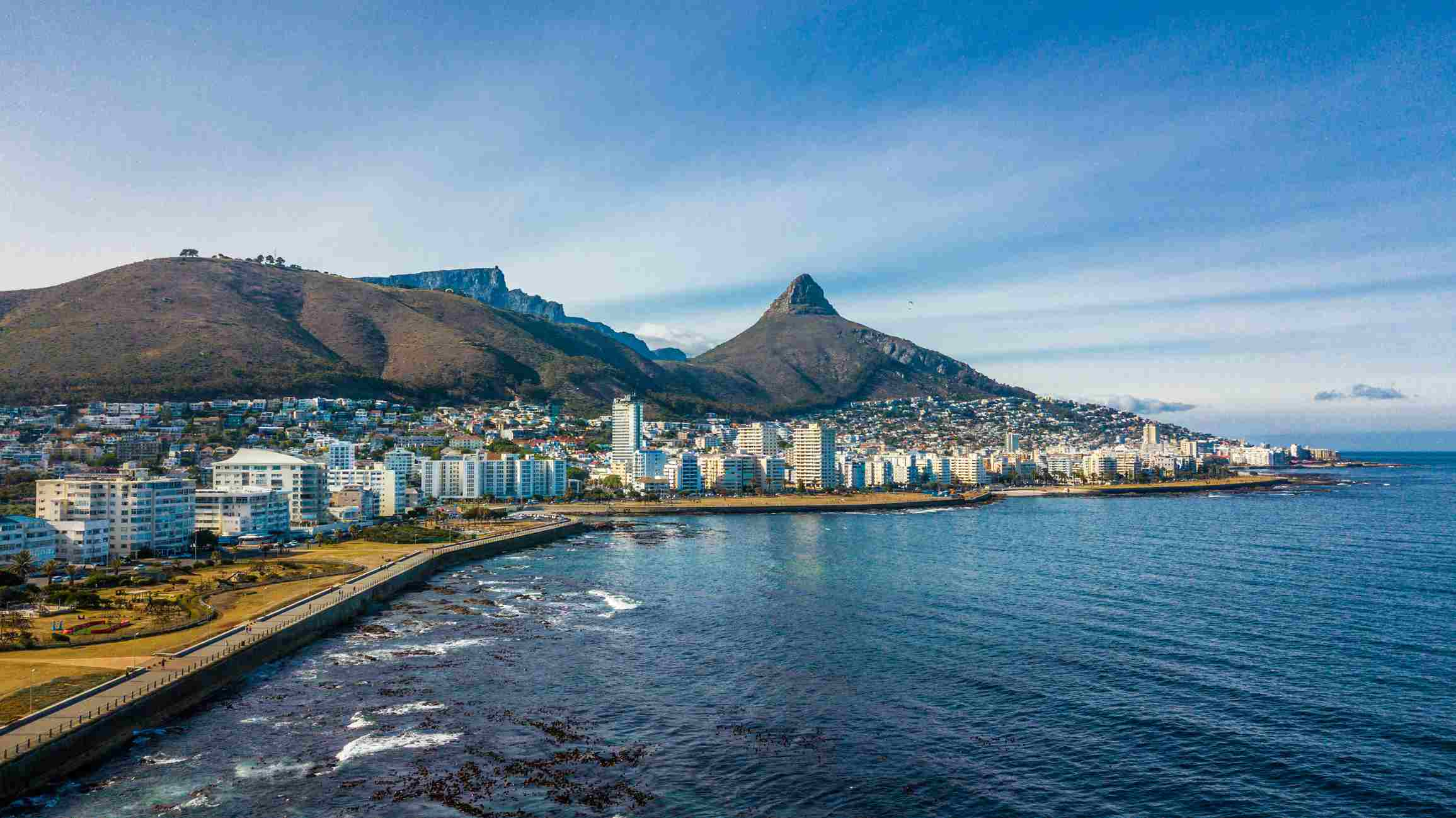 Aerial view of Sea Point, a wealthy suburb on Cape Town's Atlantic seaboard, In the background are Signal Hill, Lion's Head and Table Mountain