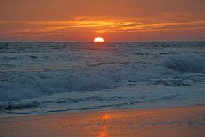 Sunset over ocean at Long Beach, NY.