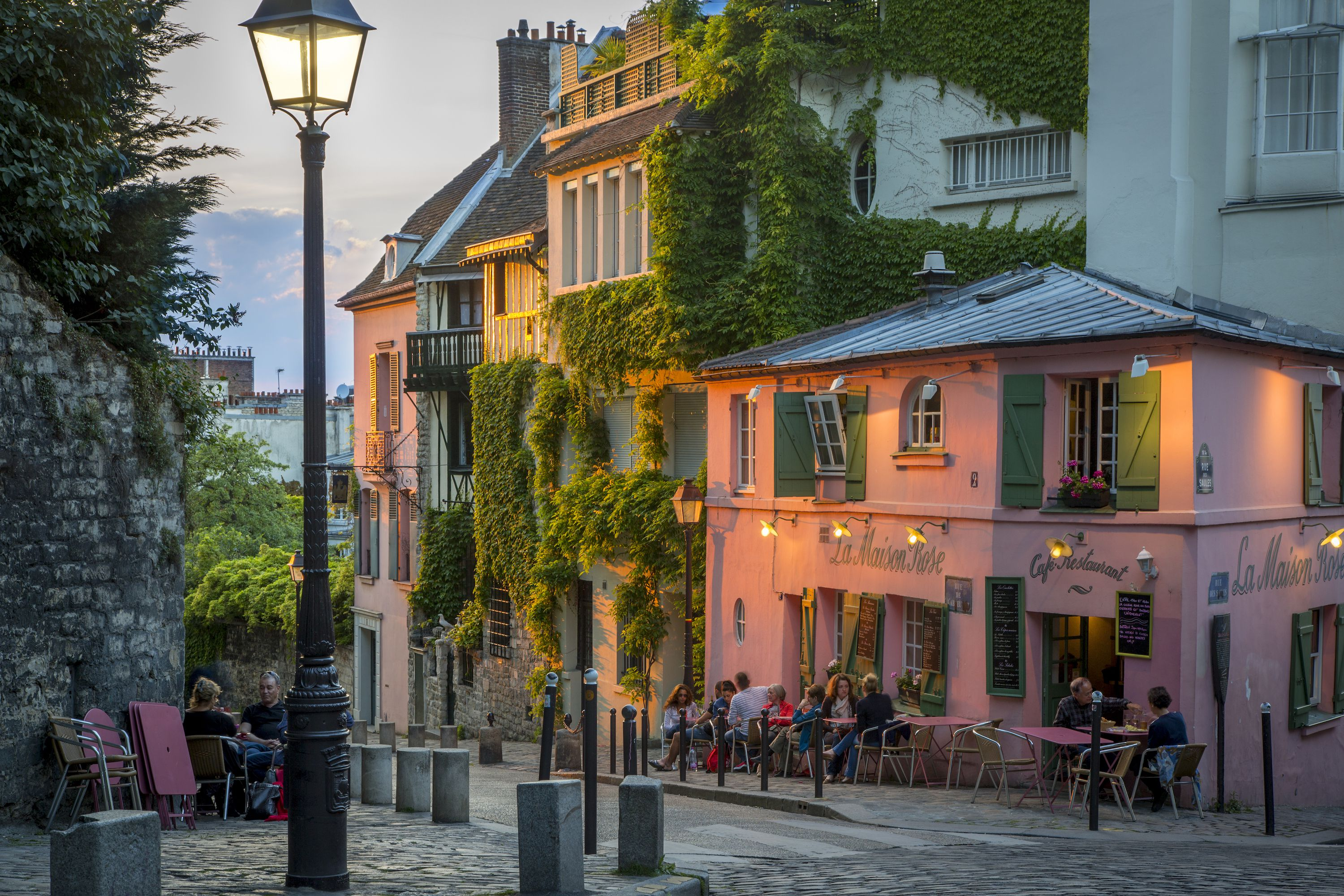 The village-like backstreets of Montmartre are heavenly during sunset on a summer evening.