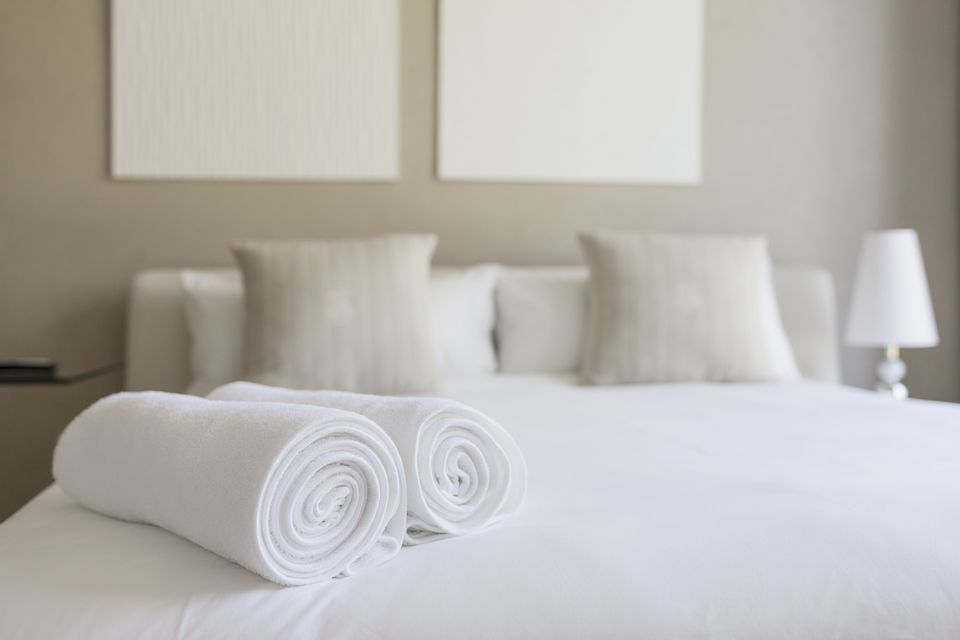 towels rolled up on hotel bed