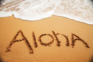 Aloha written on the sand in Hawaii