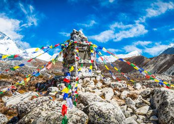 Colorful Buddhist prayer flags flying high in Himalaya mountains Nepal