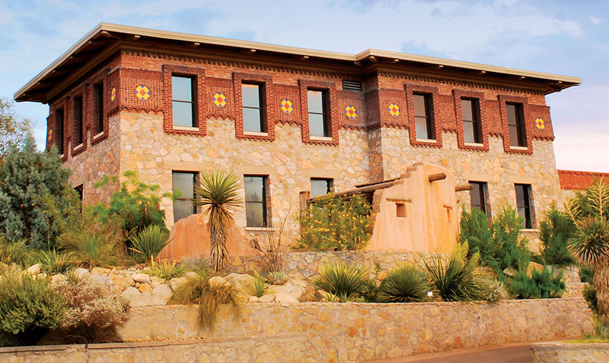 southwestern style stone and brick building with desert landscaping out from