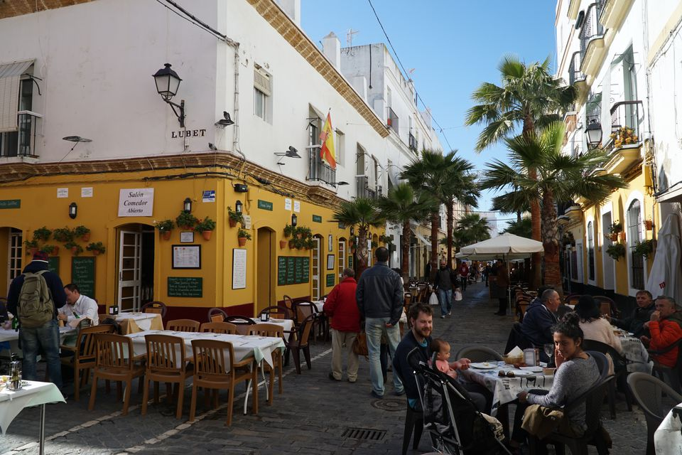 People eating outside on Calle Virgen de la Palma, Cadiz
