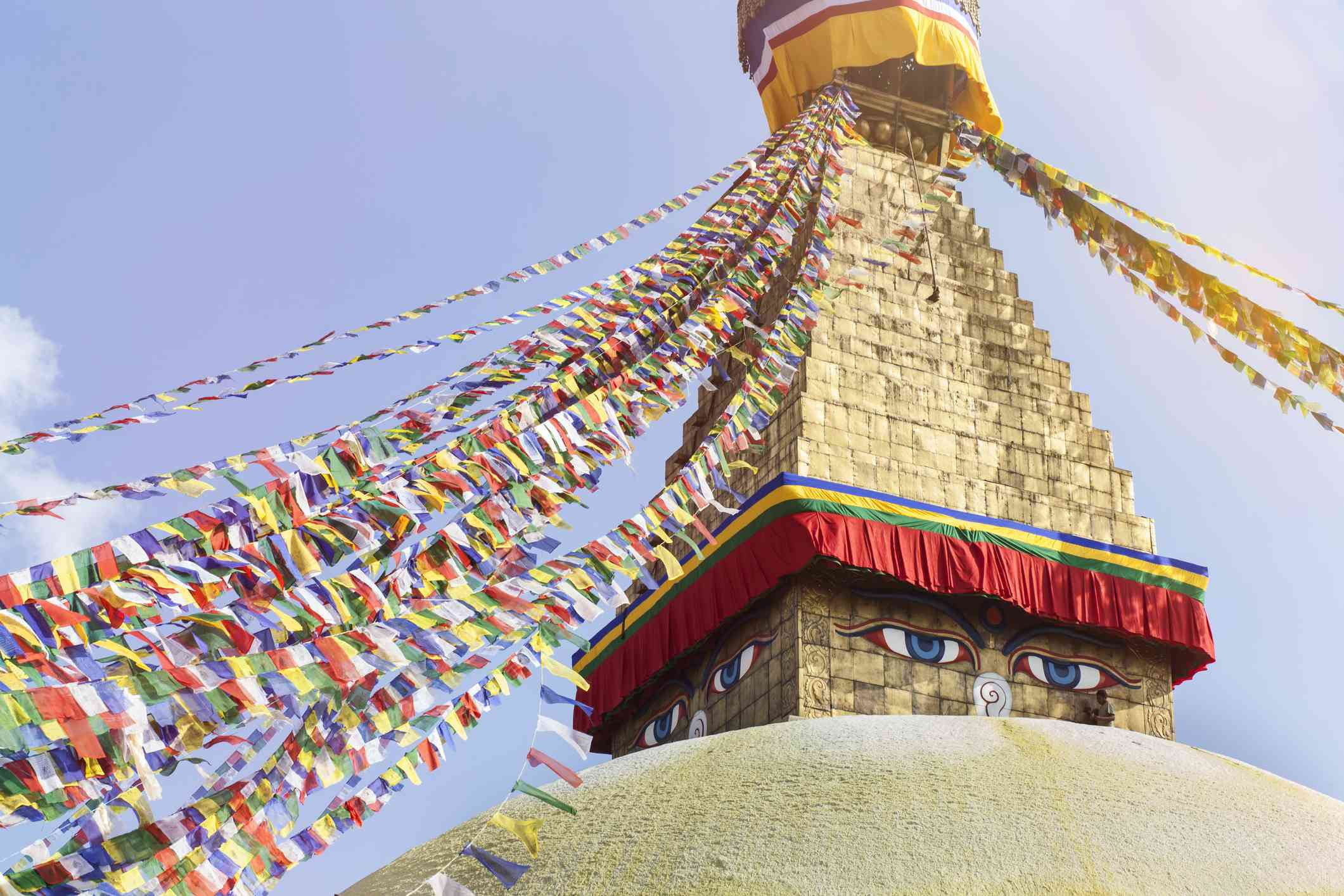 golden Buddhist stupa strung with colorful prayer flags