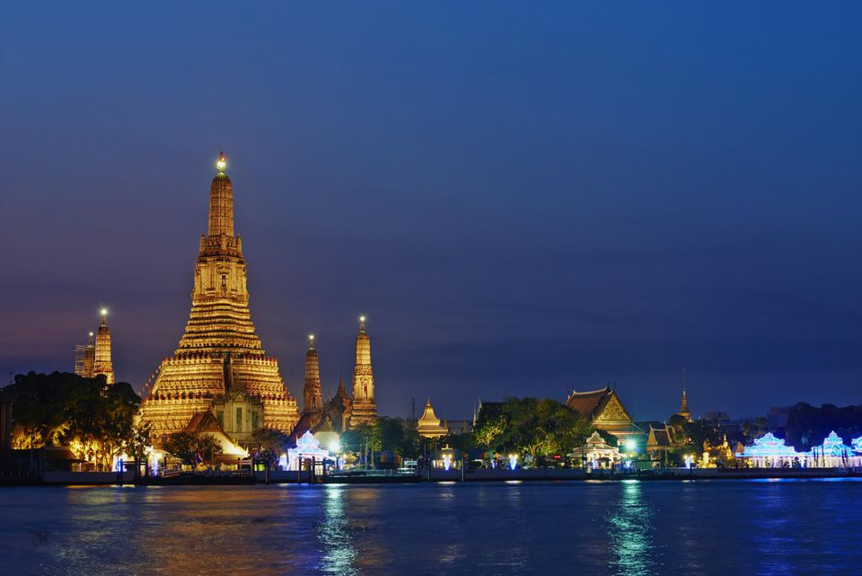 Wat Arun and Chao Phray illuminated at night, Bangkok, Thiland