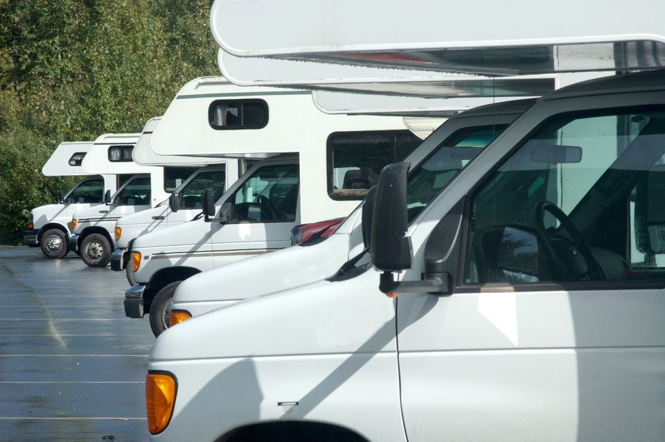 A variety of RVs in a parking lot