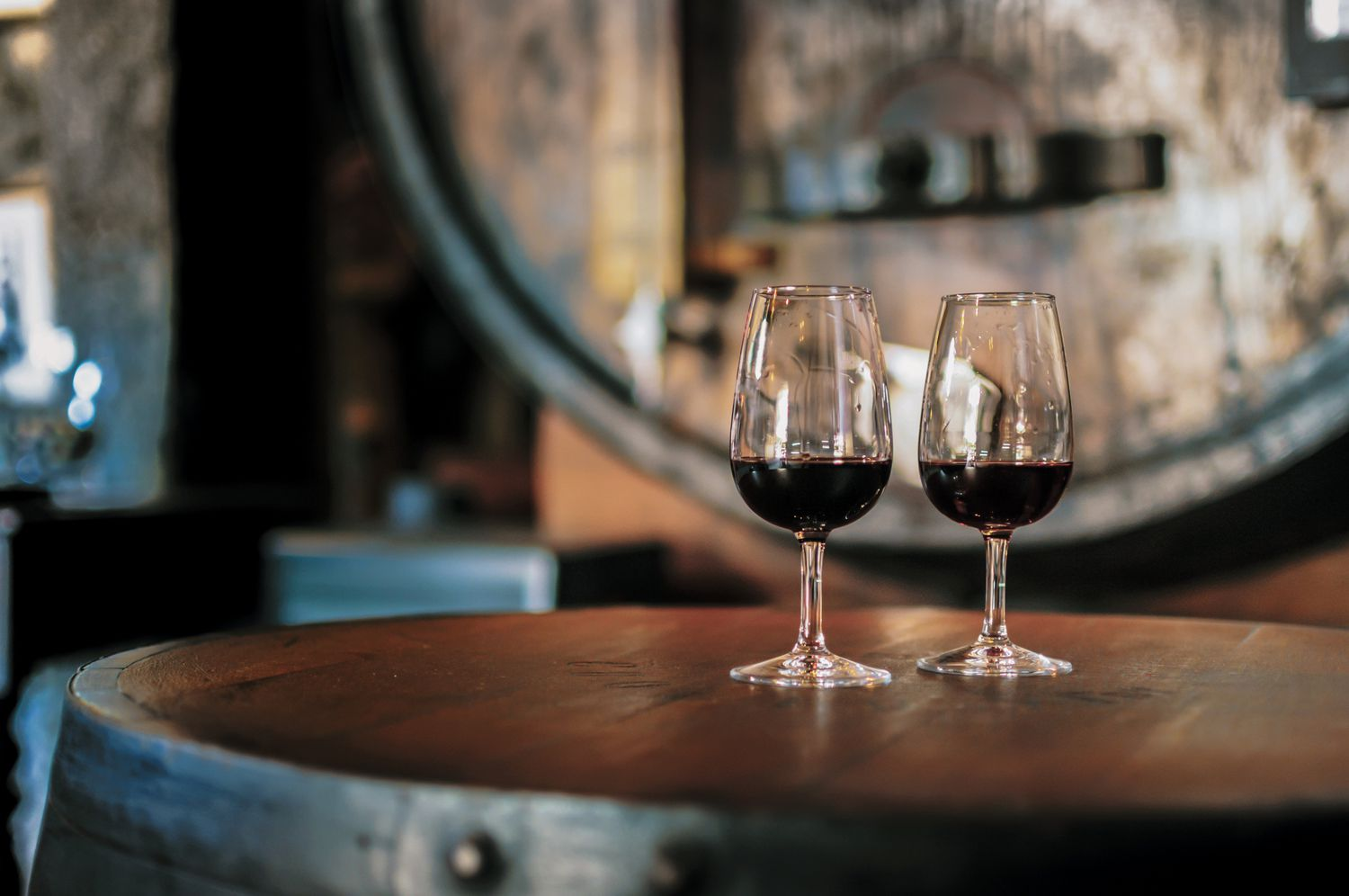 Glasses of red wine on a barrel