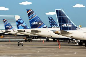 Designs on JetBlue planes with illustrated lines and clouds