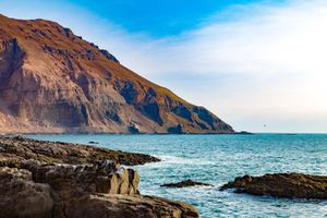Scenic View Of Sea By Cliff Against Sky in Arica Chile