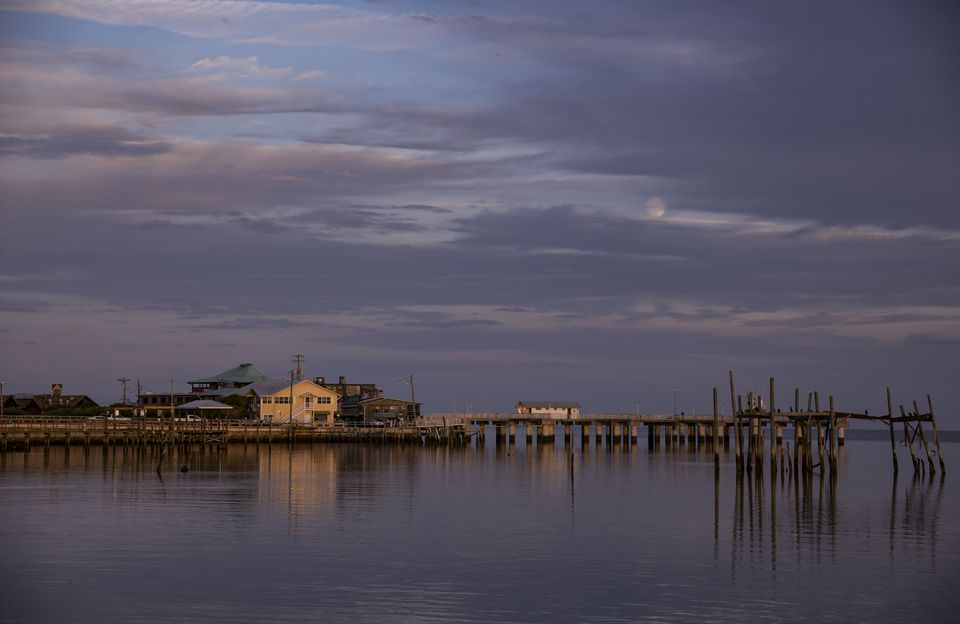 Evening sky with moonrise over Dock Street in Cedar Key, Florida