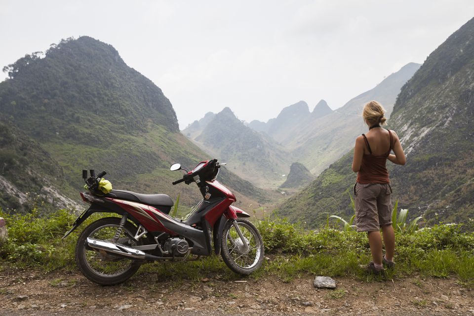 A woman rents motorbike to reach beautiful landscape