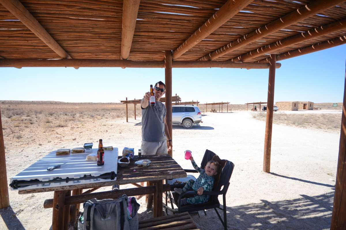 Father and daughter picnicking in Kgalagadi Transfrontier Park