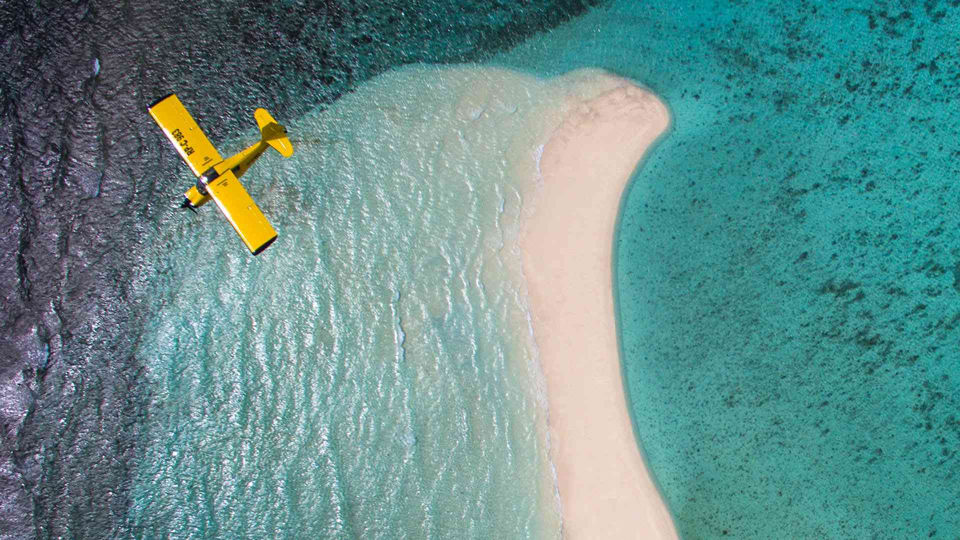 Aircraft flying over Camiguin's White Island