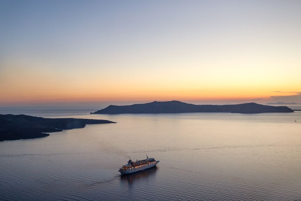 Cruise ship at sunset in Santorini, Aegean islands, Greece