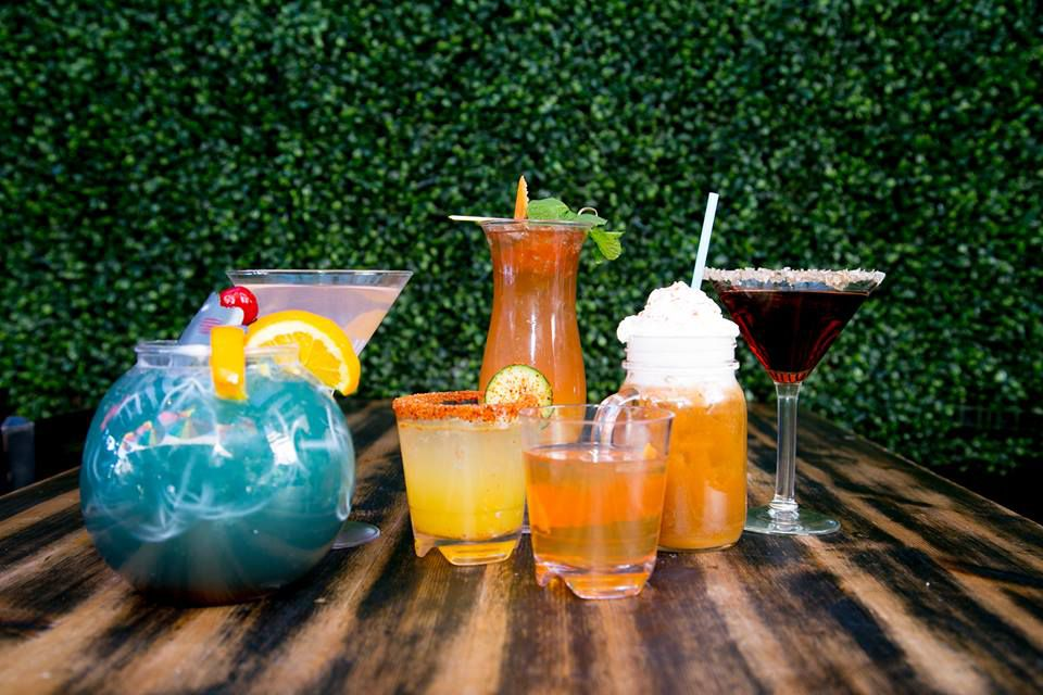 A line of colorful drinks of all sizes from Gossip Grill