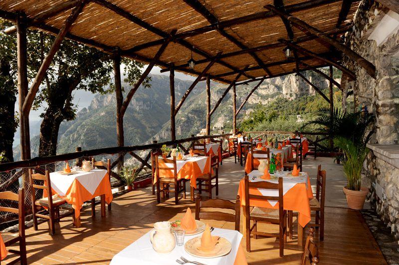 Covered patio seating at La Tagliata