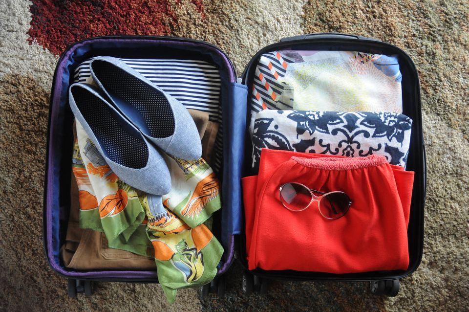 Packed Suitcase with Women's Clothing