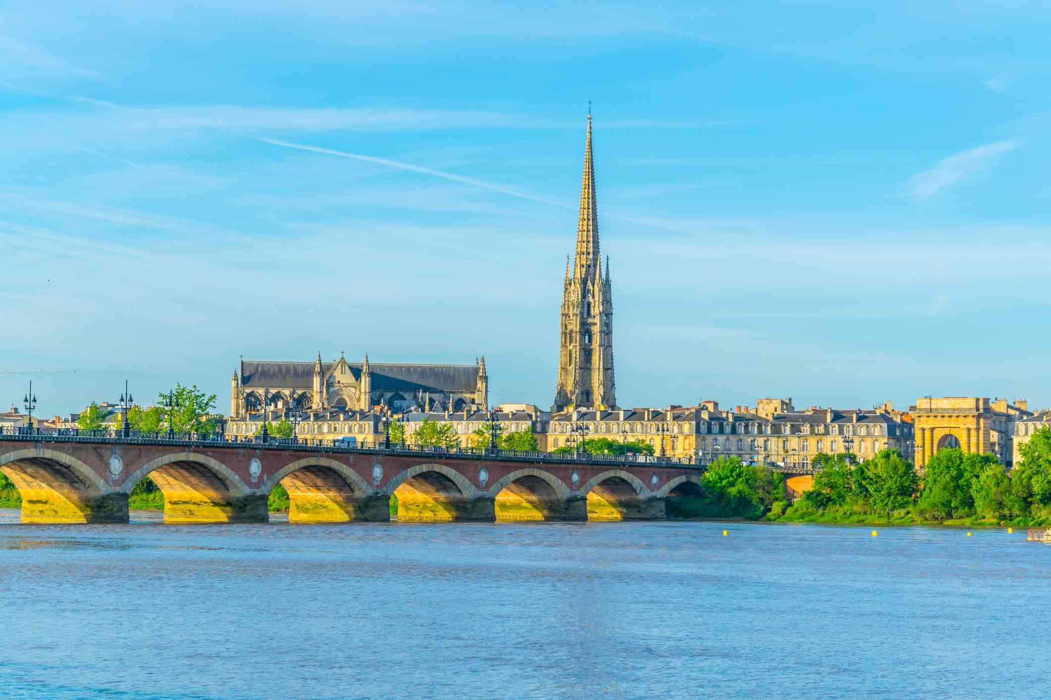 Pont de Pierre and basilica of Saint Michel in Bordeaux, France