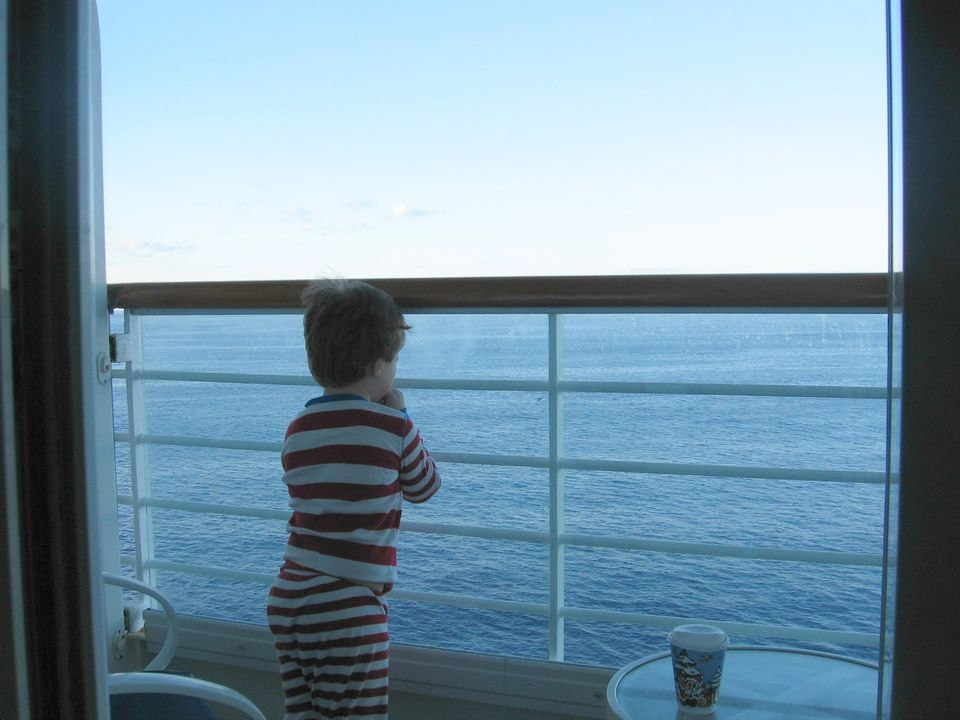 Little boy overlooking a cruise deck