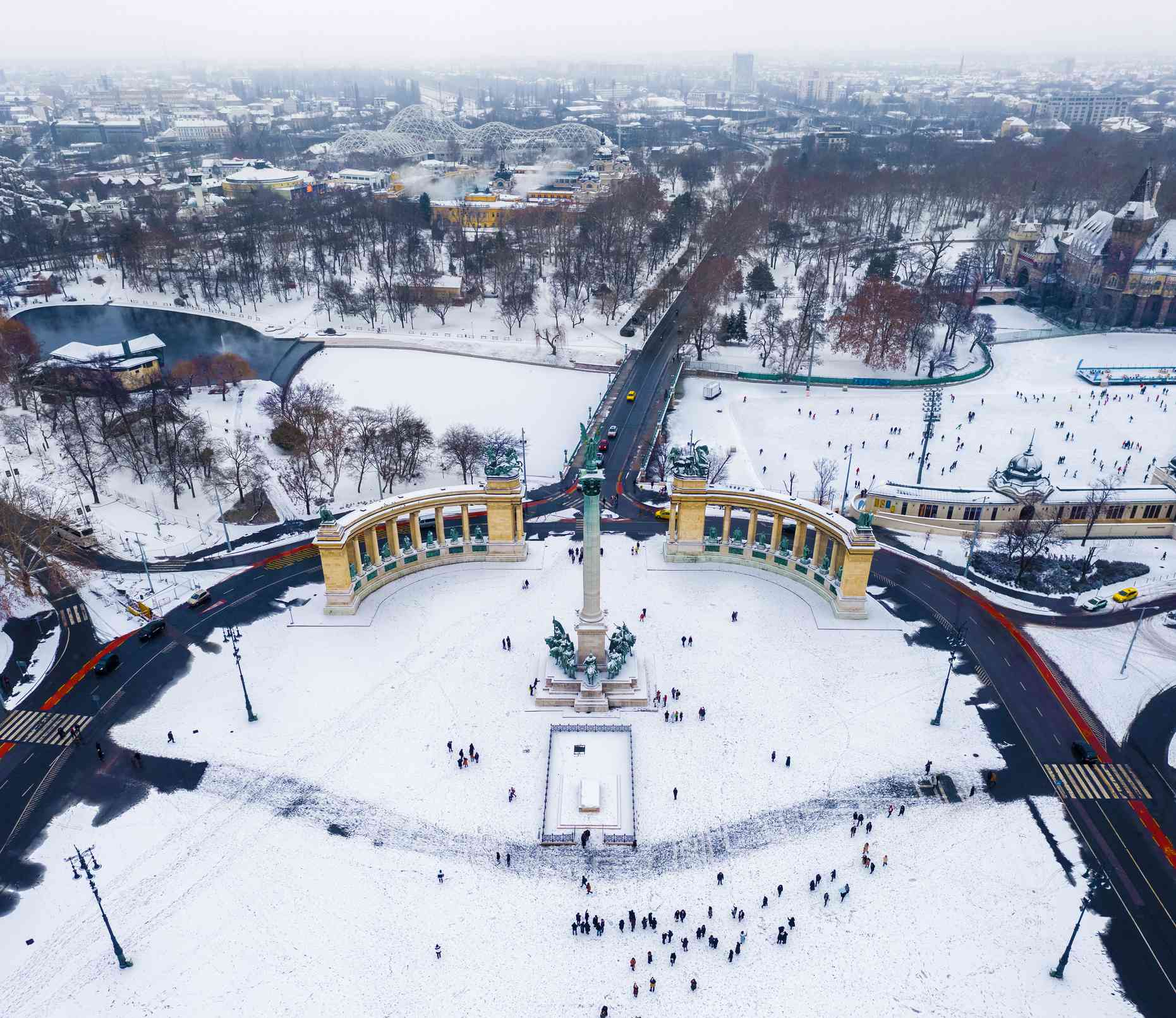 Budapest, Hungary - Snowy Heroes' Square and Millennium Monument from above on a cold winter day with City Park, Szechenyi Thermal Bath and ice rink at background