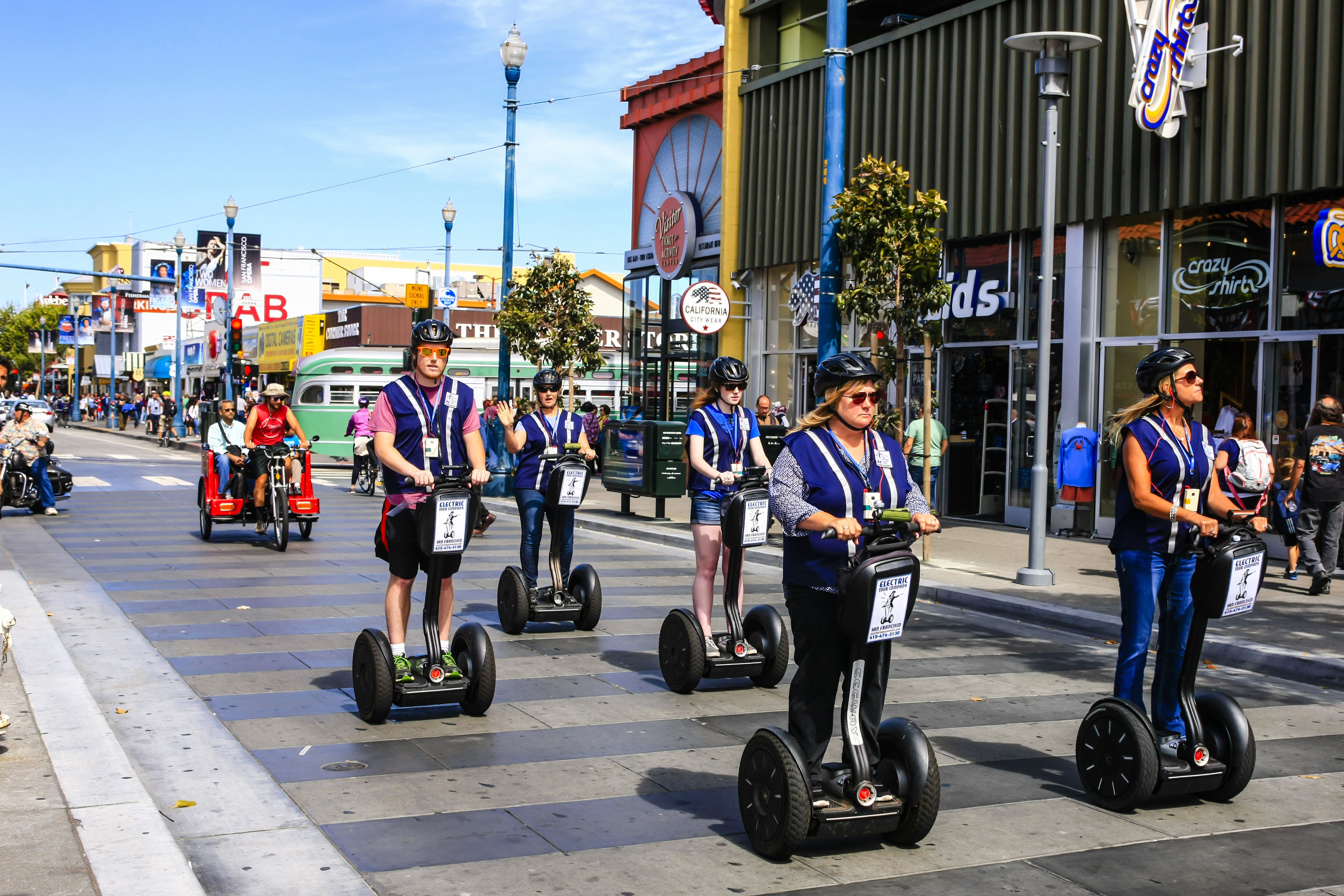People riding Segway's in Fisherman's Wharf area of San Francisco