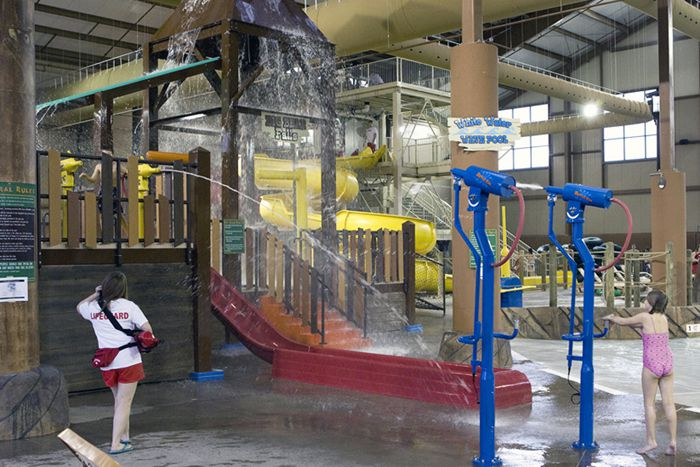 Children play on one of the many playscapes at Cascades Indoor Waterpark