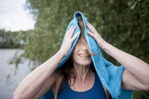 Woman drying off hair with towel