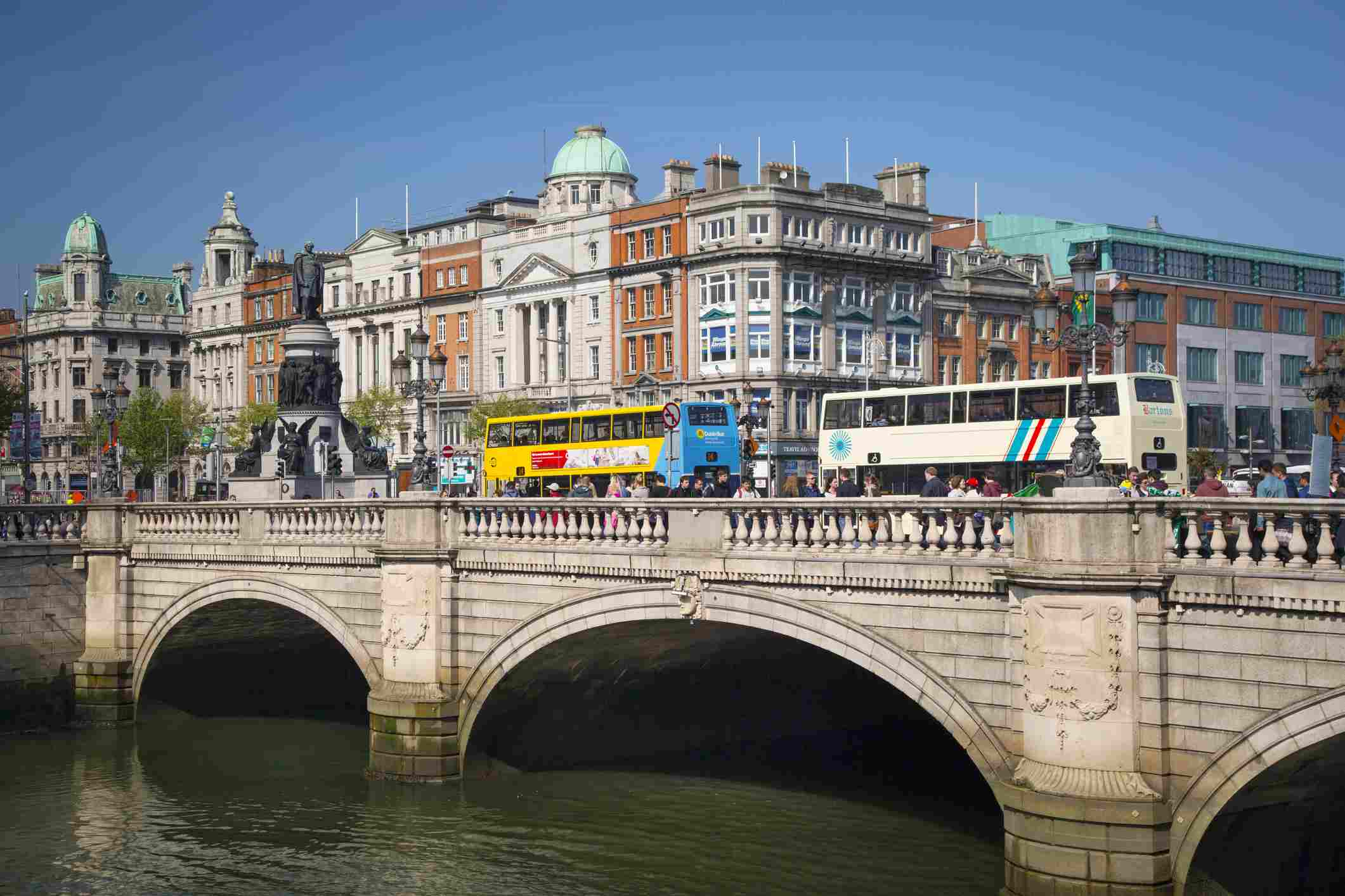OConnell Bridge is a road bridge spanning the River Liffey in Dublin, and joining OConnell Street to DOlier Street, Westmoreland Street and the south quays. The original bridge was designed by James Gandon, and built between 1791 and 1794. OConnell Bridge is said to be unique in Europe as the only traffic bridge wider than it is long. When the bridge was reopened c.1882 it was renamed for Daniel OConnell when the statue in his honor was unveiled.
