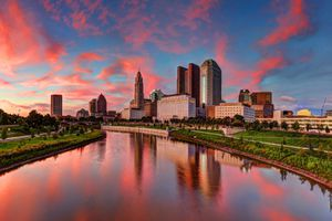 Columbus, Ohio cityscape on a river at sunset