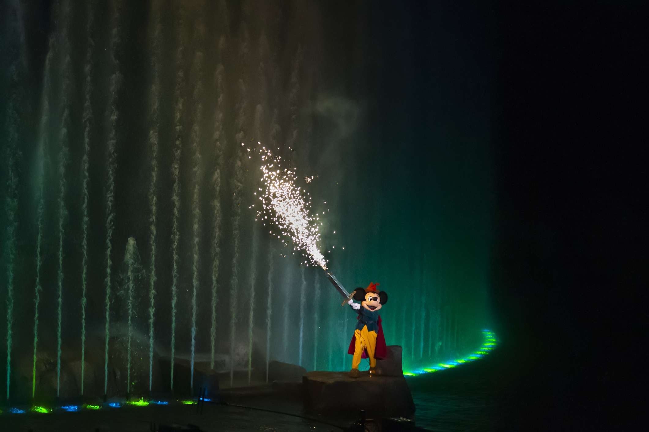 Fantasmic! with Mickey Mouse shooting fireworks